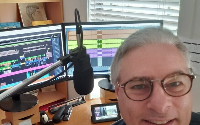 Silberblatt at the microphone in his home office recording studio.
