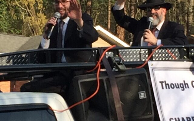 Rabbis Dov Foxbrunner and Ilan Feldman of Congregation Beth Jacob ride through the Toco Hills neighborhood offering Shabbat greetings.