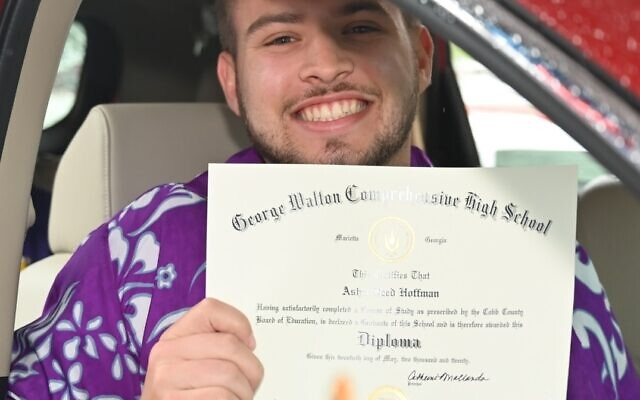 Asher Hoffman receives his diploma from Walton High School.