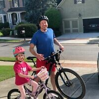 Dan Goldman bikes with daughter Amelia.