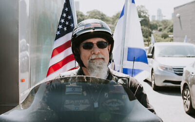 Photos by Shelbelle Lapidus //  Motorcyclist Wayne Markman was proud to fly both the American and Israeli flags.