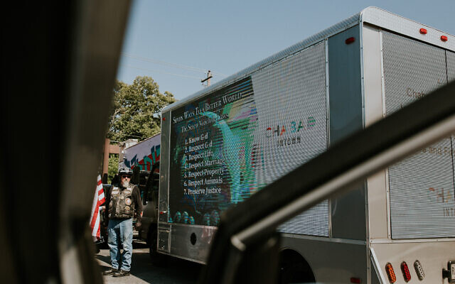 Intown Chabad decorated a truck blasting positive messages and a video.