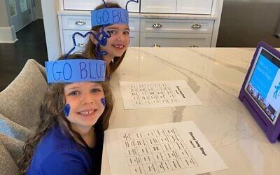 Harper and Reese Furman participate in bingo.