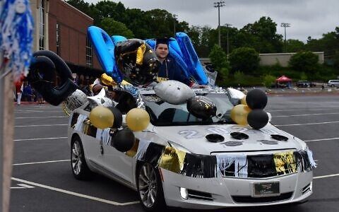 Photo by apPhotoMarietta LLC // Bradley Rudy is surrounded by balloons and other decorations at his non-traditional graduation from Walton High School.