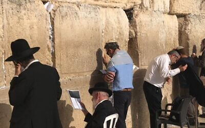 Photos courtesy of Brent Herd //  Brent Herd (center, in the blue shirt) praying at the Kotel three years ago.