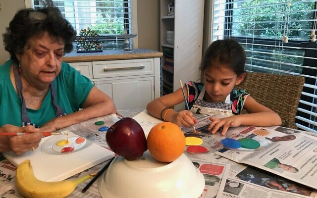 Before COVID-19, granddaughter Heidi enjoyed painting lesson with grandma.