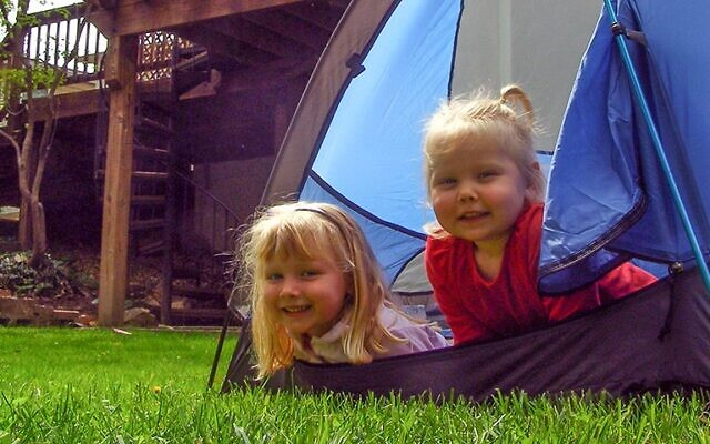 Set up a tent right in your backyard and create a camping experience.