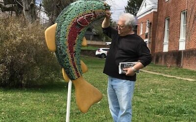 Philip Karlick checks out the colorful trout sculpture.