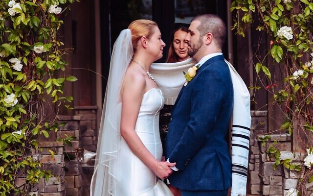 The couple exchanged vows while Rabbi Samantha Trief blessed them.