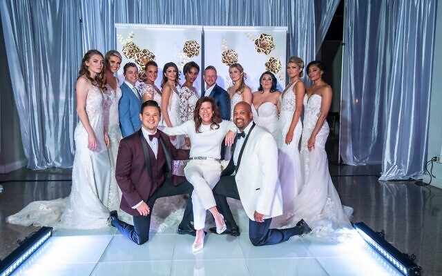 Shelly Danz, producer of the Bridal Extravaganza of Atlanta, poses with bride and groom models following a successful fashion show at the Southern Exchange Ballrooms in January.