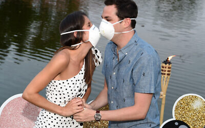 Jordyn Aronowitz and Blake Simon celebrate their engagement mask to mask.