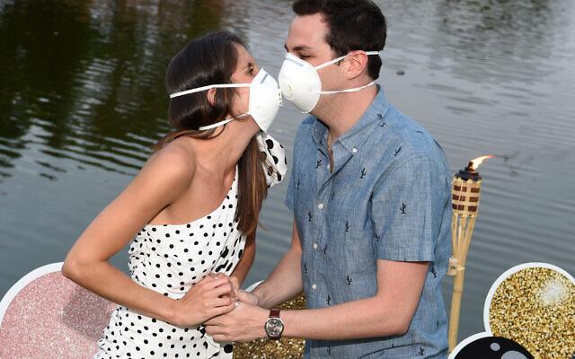 Jordyn Aronowitz and Blake Simon celebrate their engagement mask to mask.