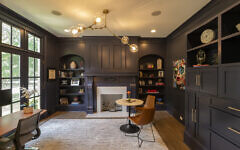 """The study had a dramatic renovation with painted fireplace, tons of built-ins and cabinets painted a charcoal blue. Greenwald likes that her desk faces the street to watch the kids play. """"Face"""" far right- Greenwald selected as fun pop art."""