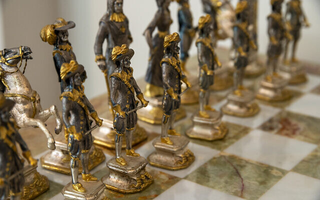 The unusual estate chess set is pewter and gold plated.