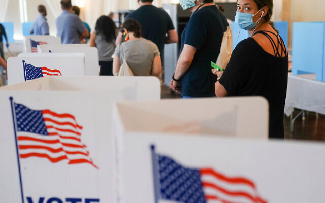 People waited in long lines on Tuesday to vote in Georgia's primary. ELIJAH NOUVELAGE / GETTY IMAGES