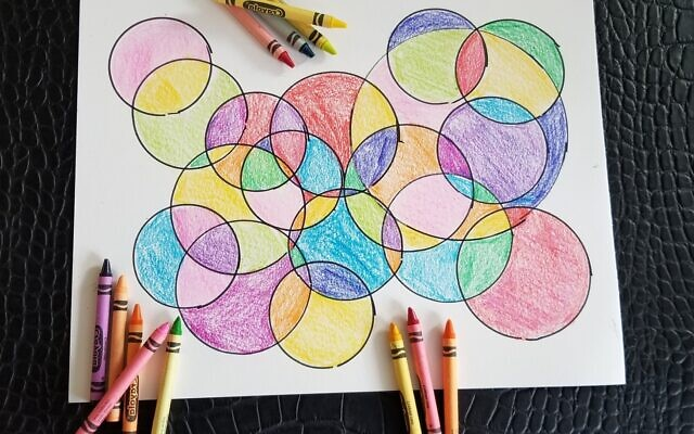 Photo by Flora Rosefsky // Using crayons to fill in an original design is an art activity for all ages.