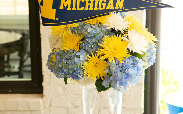 A family of Michigan fan-friends delivered an arrangement in school colors.
