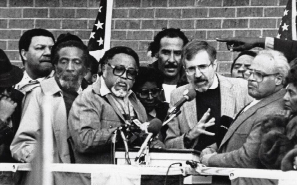 Rabbi Alvin Sugarman at the January 1987 march in Forsyth County, flanked by civil rights activists including Dick Gregory, Hosea Williams, Benjamin Hooks, Andrew Young, and others. (Photo provided by The Temple)