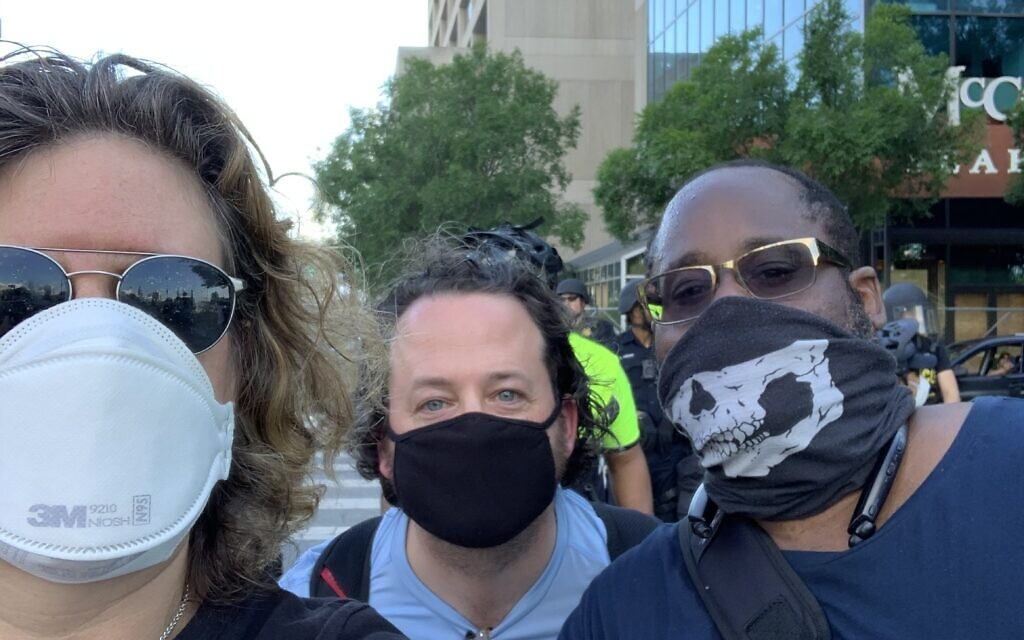 Rabbi Brad Levenberg, flanked by Beth Schafer and Andre Parker, wrote in the AJT about his participation in recent demonstrations.