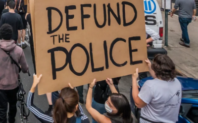 "Street demonstrations across the country have heard calls to ""Defund the Police."""