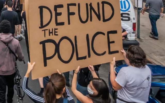 """Street demonstrations across the country have heard calls to """"Defund the Police."""""""