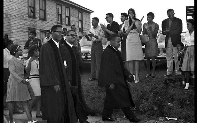 """Three ministers marching: Johnson's grandfather Rev. N.H. Smith Jr.; Rev. A.D. King, Dr. King's brother; and Rev. John T. Porter are known as the """"Birmingham trio"""" for leading marches in that city in support of desegregation."""