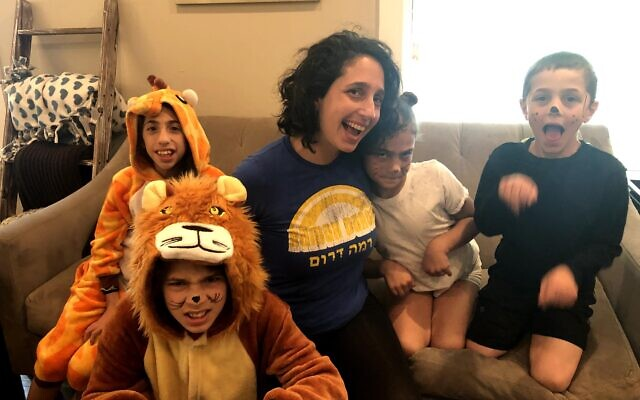 Emily Kaiman and her four children, acting as pets here, have found adoption a challenge.