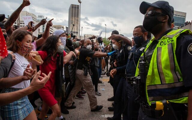 Protesters confront Atlanta police outside of the CNN center and State Farm Arena Friday, May 29. Protesters and police clashed after a peaceful march over the death of George Floyd in Minneapolis May 25, 2020.