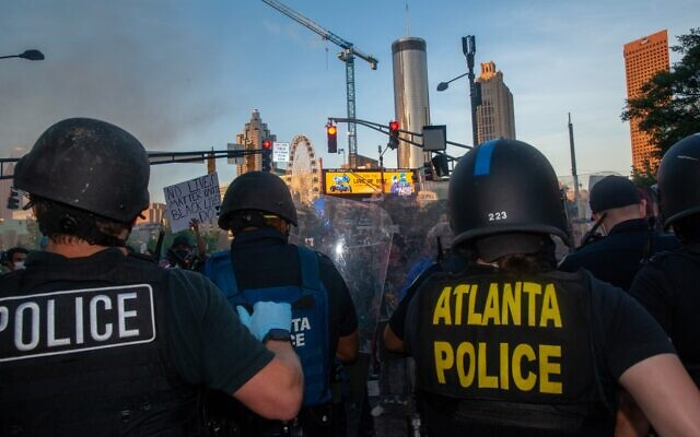 Atlanta police push back protesters using riot shields May 29.