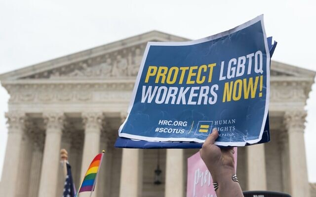 Demonstrators in favor of LGBT rights rally outside the US Supreme Court in Washington, DC, October 8, 2019, as the Court holds oral arguments in three cases dealing with workplace discrimination based on sexual orientation. Saul Loeb | AFP | Getty Images