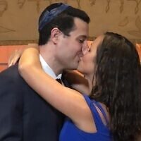 Stephanie Lievense and Andrew Cohn seal their union with a kiss.