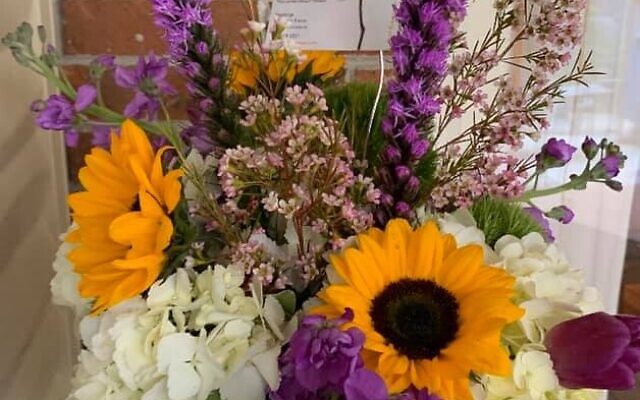3 This yellow and purple arrangement includes sunflowers and stock.