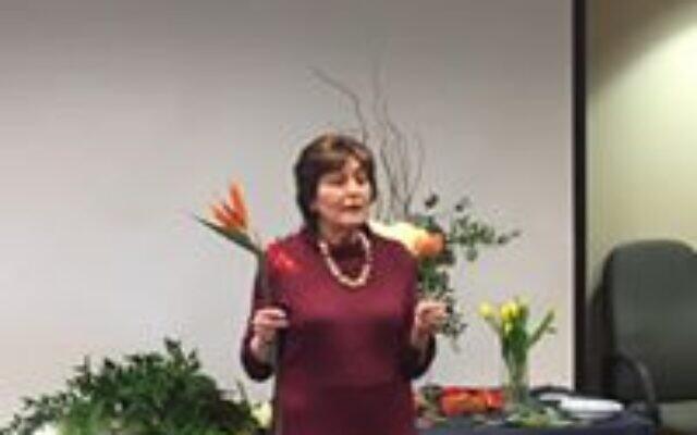 Joan Rubenstein teaching a flower arranging class.