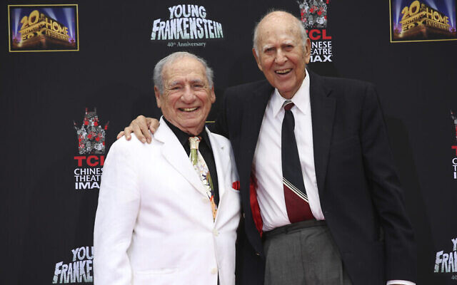 "FILE - In this Sept. 8, 2014 file photo, Mel Brooks, left, stands with Carl Reiner during Brooks' hand and footprint ceremony on the 40th anniversary of the movie ""Young Frankenstein,"" in Los Angeles. Reiner, the ingenious and versatile writer, actor and director who broke through as a ""second banana"" to Sid Caesar and rose to comedy's front ranks as creator of ""The Dick Van Dyke Show"" and straight man to Mel Brooks' ""2000 Year Old Man,"" has died, according to reports. Variety reported he died of natural causes on Monday night, June 29, 2020, at his home in Beverly Hills, Calif. He was 98. (AP Photo/Nick Ut, File)"