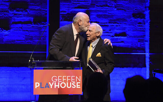 Rob Reiner, left, presents the Distinction in Theatre award to Mel Brooks at Backstage at the Geffen Gala on Sunday, March 19, 2017, in Los Angeles.(Photo by Matt Sayles/Invision for Geffen Playhouse/AP Images)