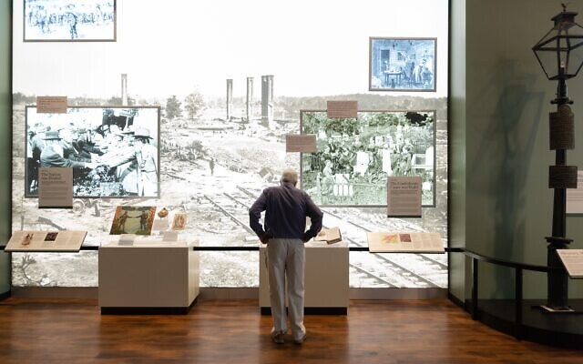 "Courtesy of Atlanta History Center // A visitor explores the history center exhibition, ""Cyclorama: The Big Picture."""