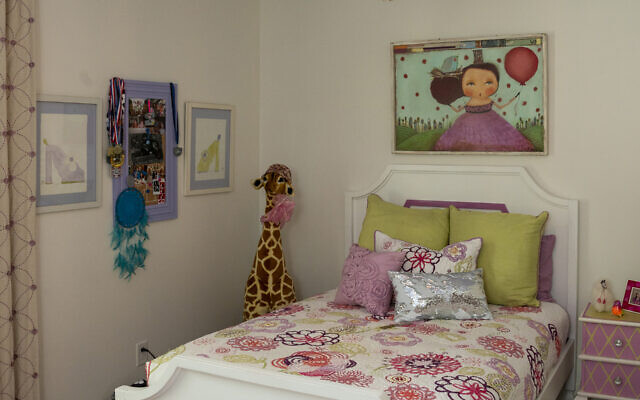 Shaina's cheerful room has a Pottery Barn rug and beaded chandelier from Ro Sham Beaux.