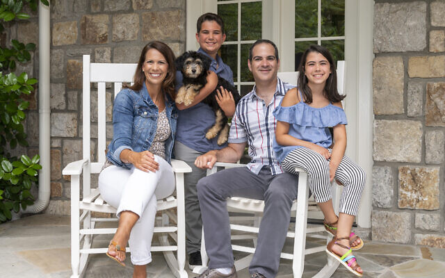 Photos by Duane Stork // The Levins enjoy the porch of their replica of an 18th century Pennsylvania stone farmhouse with Greek revival columns. Front and center is newly adopted mini Aussie Allie.