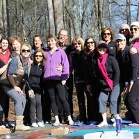 A few days before her brain biopsy in 2016, friends gave support to Karen Paz at a yoga session near the Chattahoochee River in Roswell.