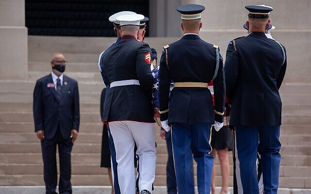 An honor guard carries John Lewis's casket into the Georgia State Capitol, where the late civil rights hero will lay in state on July 29th in Atlanta, Georgia.// Nathan Posner AJT