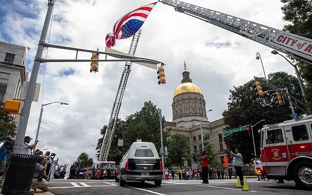 The hearse containing the casket of the late John Lewis arrives at the Georgia state capitol in Atlanta, Georgia on July 29th. // Nathan Posner AJT