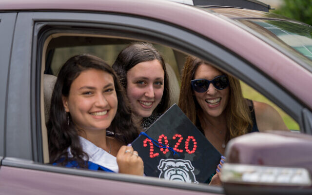 Ella Sharon supports her future college, University of Georgia, with her sister Irene and mother Michelle Robinovitz.