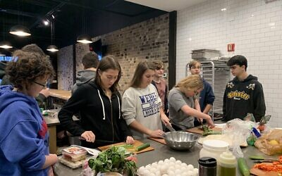 Weber Hebrew students prepare an Israeli breakfast after watching Unpacked videos about Israeli food and culture. The students gathered at the professional kitchen owned by Weber mom Cindy Stern, Yes, Chef! and prepared shakshuka, Israeli salad, hummus and other dips.