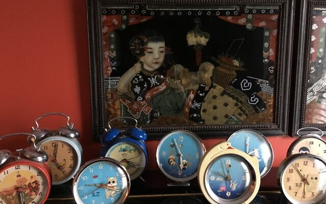 Whimsical clocks have multiple moving parts.
