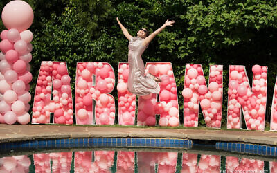 Photo credit: Chuck Robertson Photography // Arianna catches air in front of a background spelling out her name in balloons. Balloon columns by Balloons Over Atlanta.