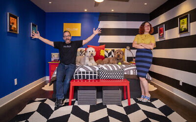 Jeff Roder marvels at wife Paola's talent in their master bedroom with her signature hand created stripes and bold colors. Doodles Kali and Lakshmi chill with their tennis balls.