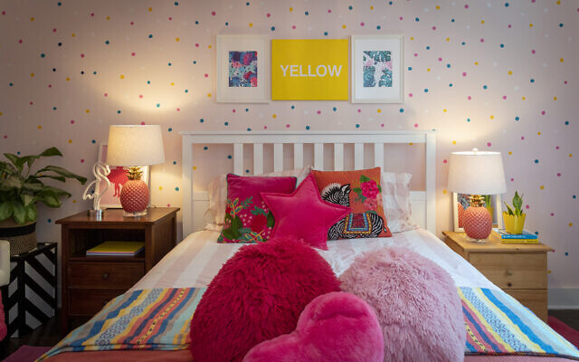 This guest bedroom designed by Paola was featured in HGTV Magazine. The dots are decals. The lamps are Novogratz.