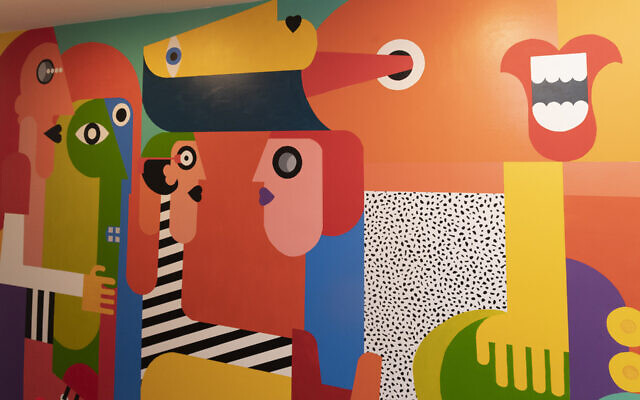 Paola is best known for crafting original murals.