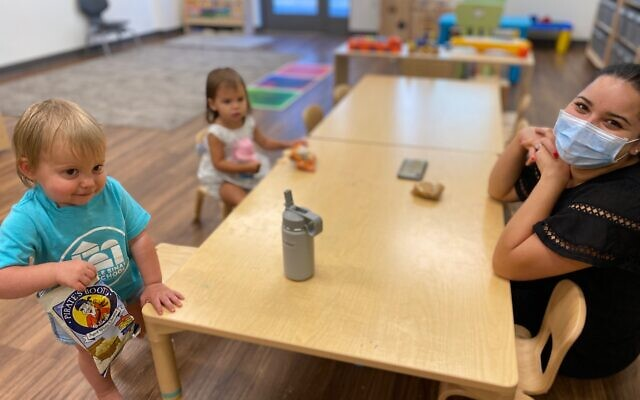 Darcy Hunter works with pre schoolers on their first day of new school year at Temple Sinai.