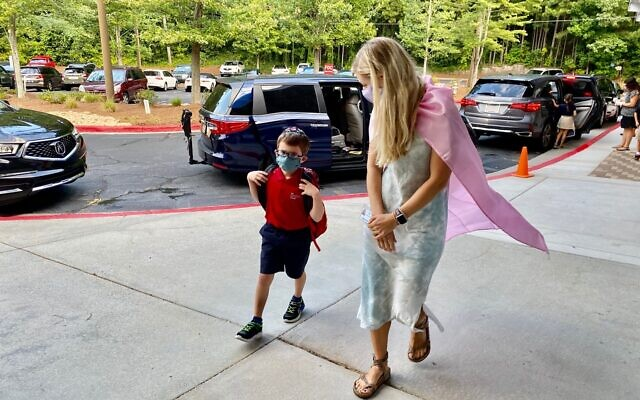 Molly Levine-Hunt walks Asher Rosenbaum into school.